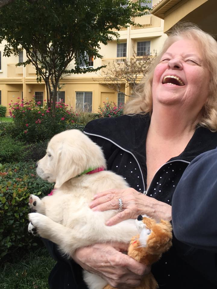 Maureen's face when she saw her puppy for the first time